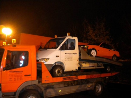 Tow truck towing a hachi towing truck
